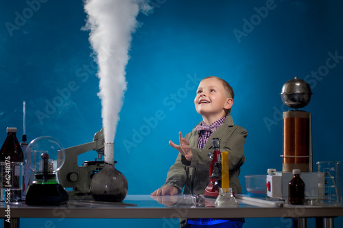 Fotografie, Obraz  Image of joyful boy watching reagent evaporation