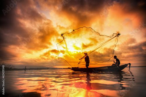 Fotografie, Obraz  Fisherman of Bangpra Lake in action when fishing