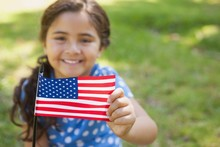 Young Girl Holding The America...