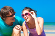 Closeup of happy young couple in sunglasses having fun on