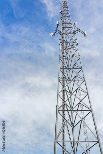 Fotografie, Obraz  Tall steel cellphone tower structure,blue sky with clouds.