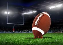 Football Ball On Grass In A Stadium