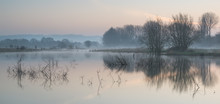 Landscape Of Lake In Mist With...