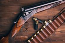 Shotgun With Shells On Wooden ...
