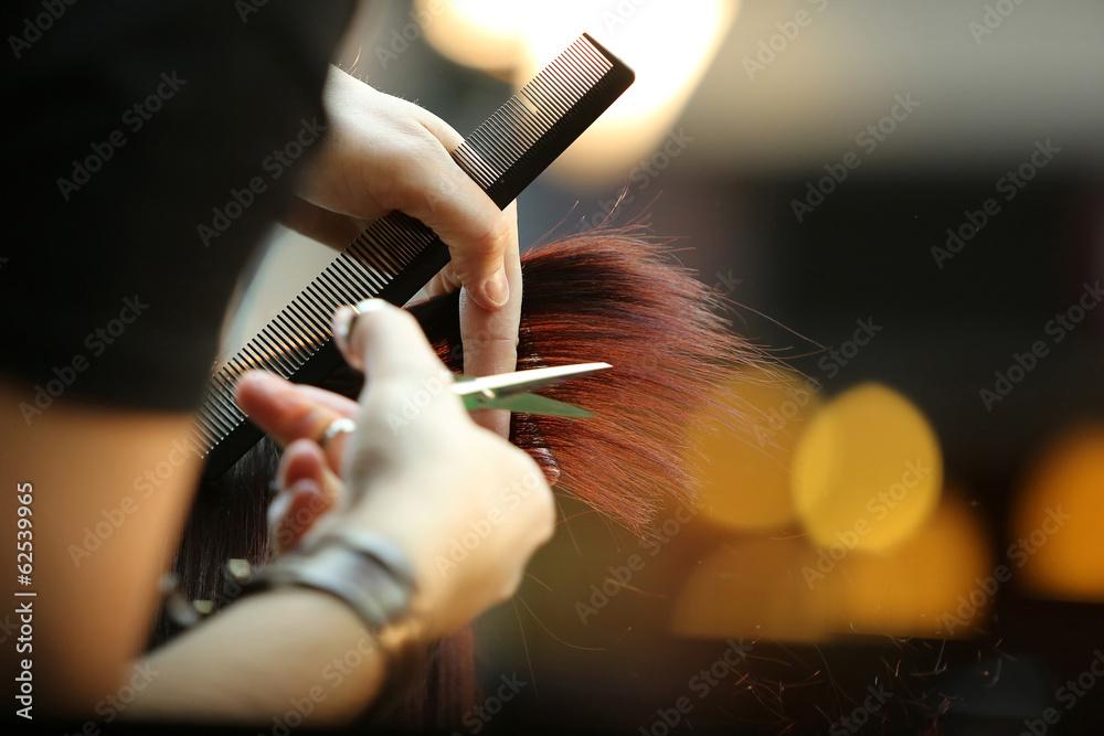 Fototapeta Barber cutting brown hair
