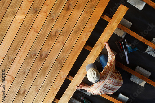 Leinwand Poster Constructing a wooden patio
