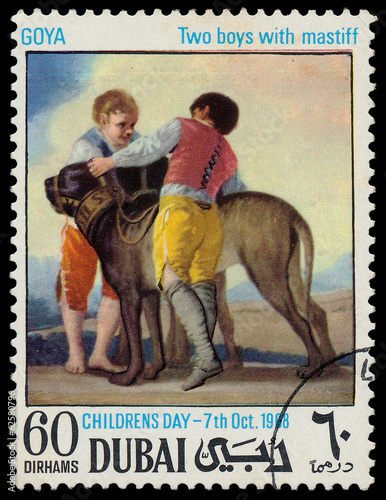 Fotografia  DUBAI - CIRCA 1968: a stamp printed by Dubai shows a picture of