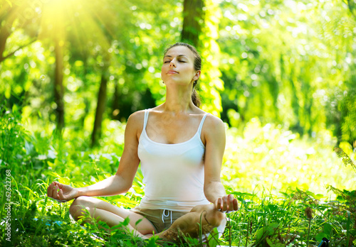 Spoed Foto op Canvas School de yoga Young Woman doing Yoga Exercises Outdoor