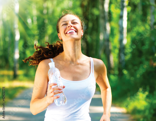 Poster Jogging Running Woman. Outdoor Workout in a Park