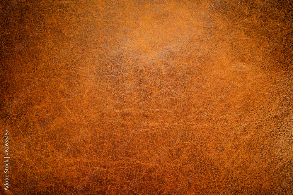 Fototapeta Brown leather textured background with side light.