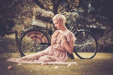 Dreaming Blond Retro Woman Sit...