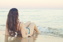 Woman On The Beach At Sunset. Vintage Effect.