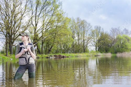 Printed kitchen splashbacks Fishing woman fishing in pond in spring