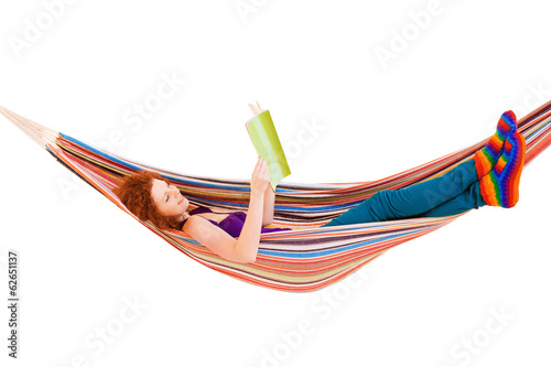 Poster  Young girl reading a magazine in a hammock