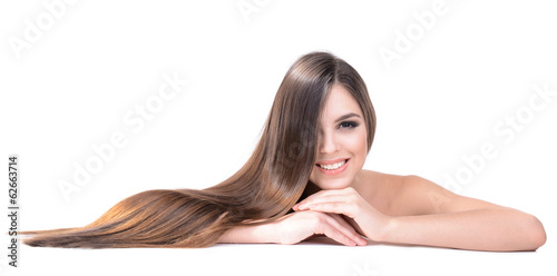 Fényképezés  Beautiful young woman with long hair isolated on white