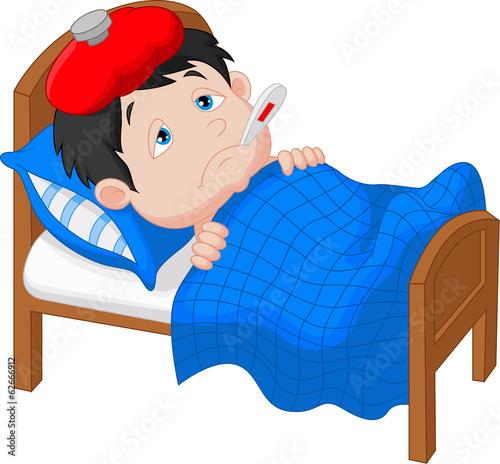 Fotografia  Sick boy lying in bed