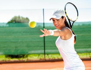 Fototapeta Female playing tennis
