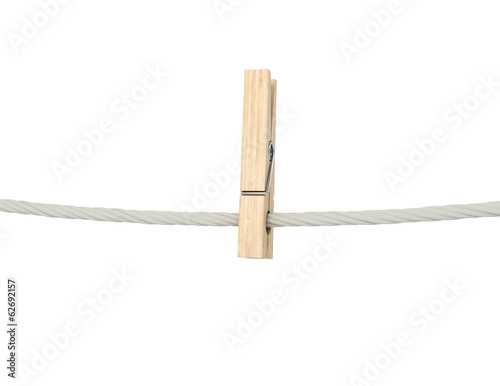 Fotografie, Obraz  wooden clothespin on a rope. Isolated on white