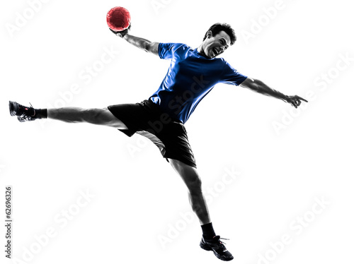 Fotografiet  young man exercising handball player silhouette