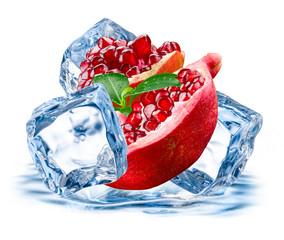 Pomegranate. Fruit with ice isolated on white background