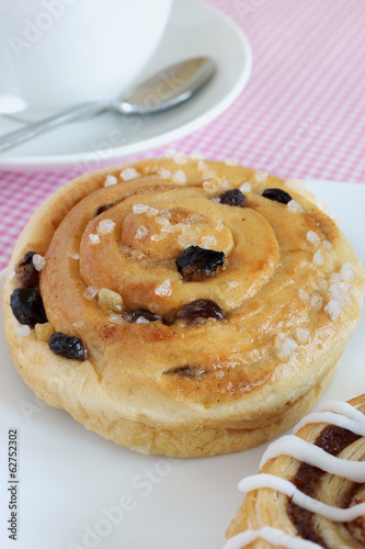Chelsea Buns a traditonal British pastry made with dried fruit Poster