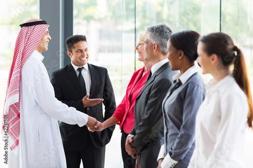 Fototapeta young translator introducing Arabian businessman obraz