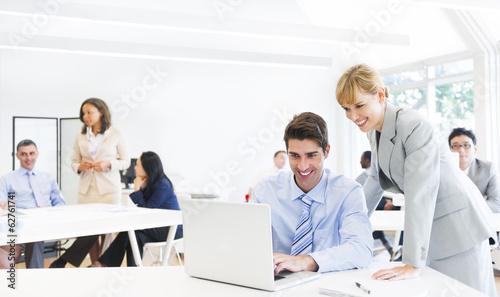 Fotografie, Obraz  Female Manager Supervising Employee At Laptop