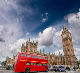 Red bus on Westminster Bridge under a dramatic sky - London