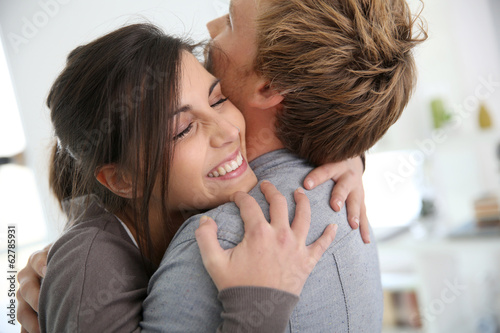 Fototapeta  Couple embracing, happy to get back together