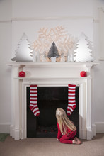 Girl Looking Into Fireplace Expecting Santa Claus