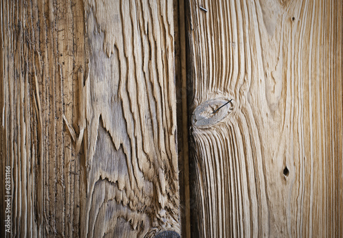 A reclaimed lumber workshop. Close up of two planks of wood, with knots and wood grain patterns.