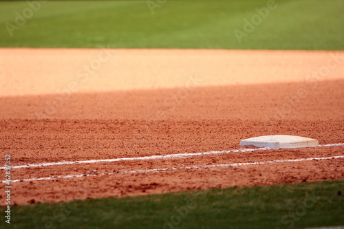 Photo  First Base Featured In Empty Baseball Field