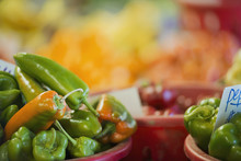Organic Assorted Green Peppers On Display