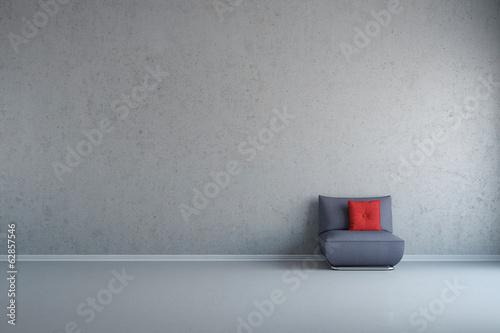 Obraz na plátně Sessel vor Wand aus Beton