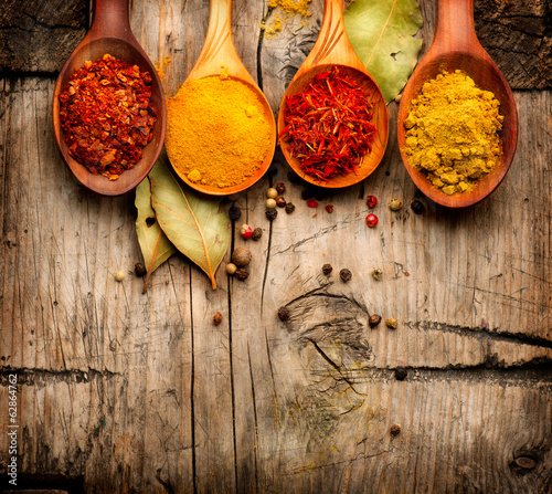 Canvas Prints Spices Spices. Curry, saffron, turmeric, cinnamon over wood