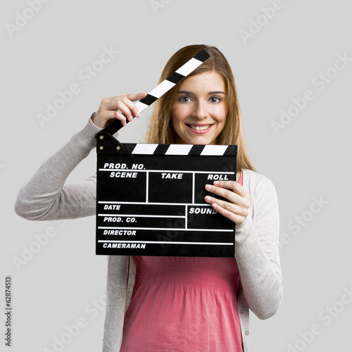 Fotografia, Obraz  Beautiful girl holding clapboard
