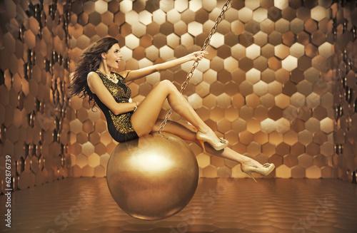 Photo  Sensual woman playing on the big ball