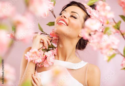 Printed kitchen splashbacks Artist KB Pleased brunette woman among the flowers
