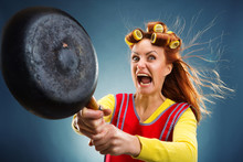 Crazy Housewife With Pan And Curlers On Her Head