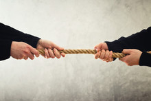Tug Of War. Hands Pulling Rope...
