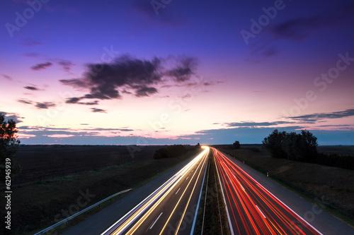 Keuken foto achterwand Nacht snelweg Cars speeding on a highway