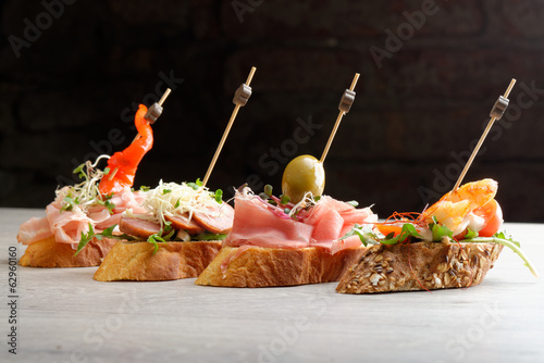 Tapas on Crusty Bread - Selection of Spanish tapas