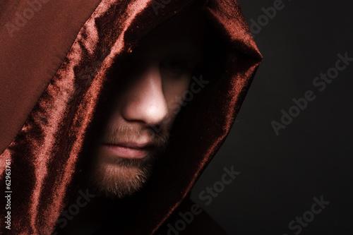 Obraz na plátně Portrait of mystery unrecognizable monk in robe