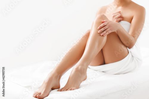 Obraz Long Woman Legs isolated on white. Epilation - fototapety do salonu