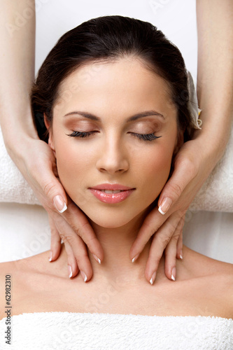 Spa Woman. Close-up of a Beautiful Woman Getting Spa Treatment  - 62982310