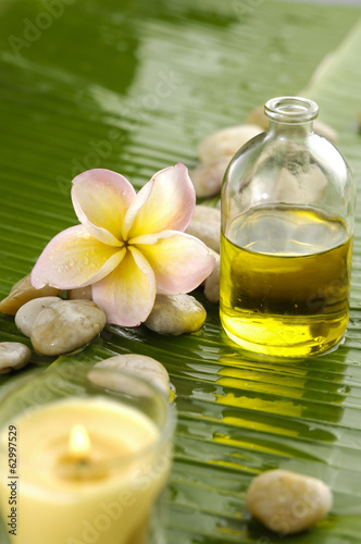 Staande foto Spa massage oil and frangipani,candle and banana leaf