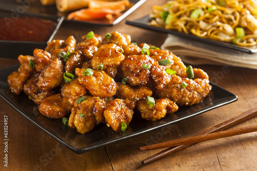 Fotografiet  Asian Orange Chicken with Green Onions