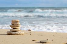 Stack Of Pebbles At The Sea Coast