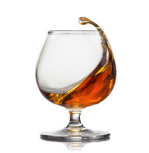 Splash Of Cognac In Glass Isol...