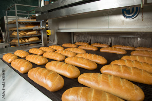 Hot baked breads on a line - 63036591